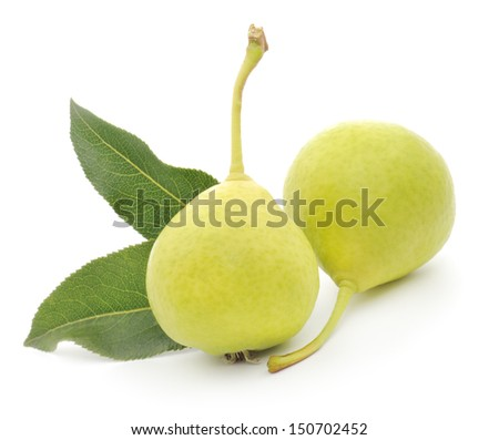 Two yellow pears with green leafs isolated on white background