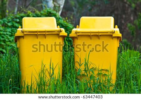 two yellow public trashcan - stock photo