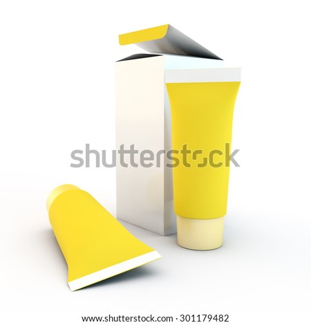 two yellow tubes for cream or toothpaste near a cardboard box