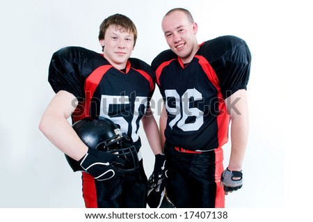 Two young American football players isolated on white background - stock photo