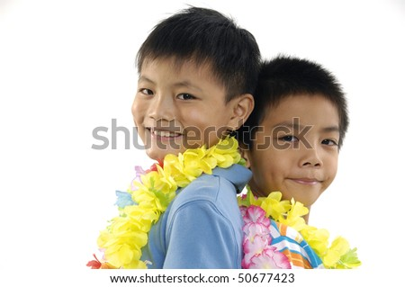 Two young Asian brothers standing back to back. - stock photo