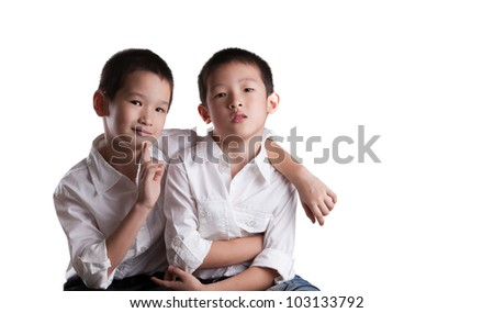 Two Young Asian Brothers wearing white shirts on an Isolated white background - stock photo