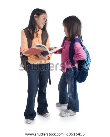Two young Asian girls ready for school - stock photo