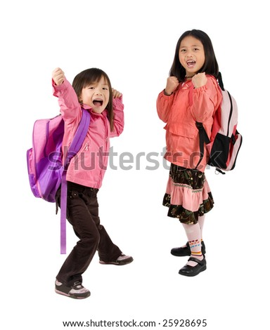 Two young asian school girls ready for school - stock photo