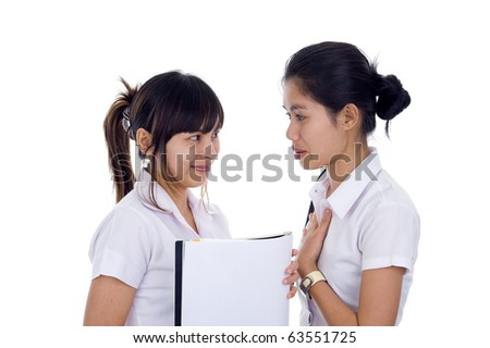 two young asian students discussing, isolated on white background - stock photo