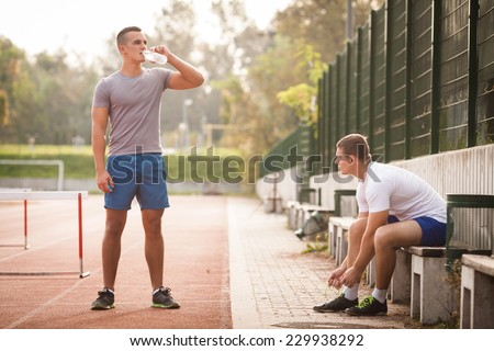 Two young athletes preparing for practice - stock photo