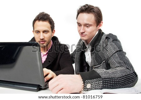 Two young attractive beautiful boy Caucasian businessman in casual clothing sitting in the office and work for laptops, business people, isolated over white,training and explanation, induct,