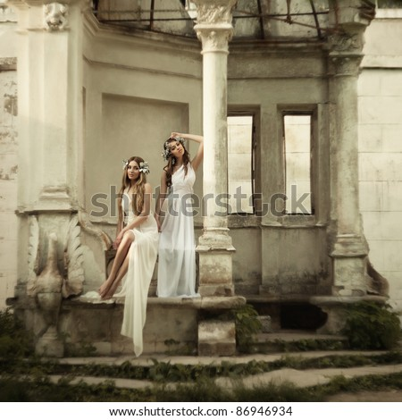 Two young attractive beautiful woman in antique style grain and texturer added - stock photo