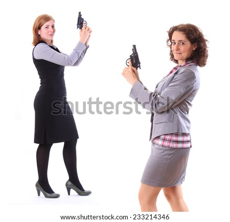 Two young beauty business women with gun - stock photo
