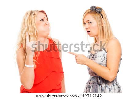 Two young blond angry shocked women arguing, isolated on white background. - stock photo