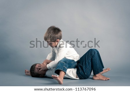 Two young brothers fighting. - stock photo