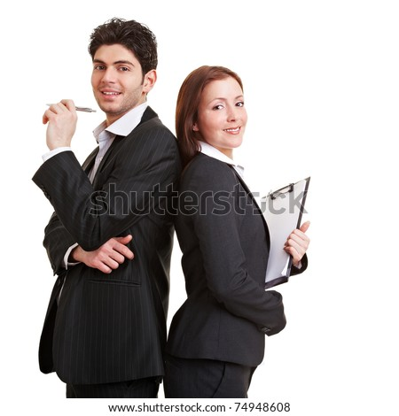 Two young business consultants leaning back to back - stock photo