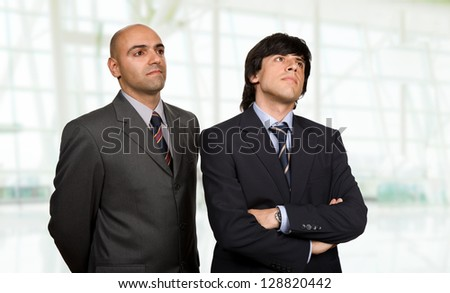 two young business men thinking, at the office - stock photo