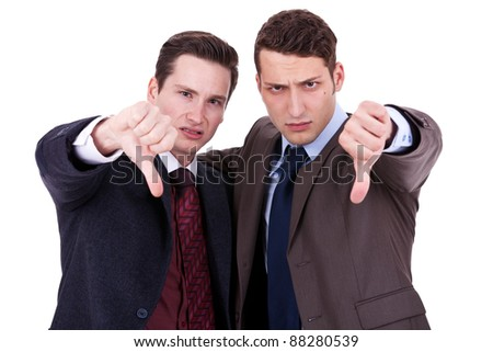 two young business men with thumb down gesture on white background