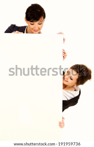 two young business women holding the whiteboard, white background