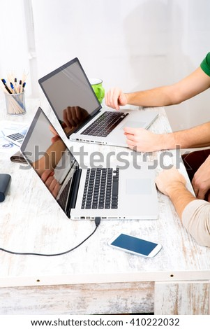 Two young businessman building up their startup company - stock photo