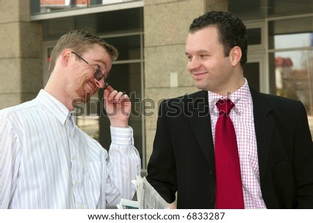 Two young businessmen smiling - stock photo
