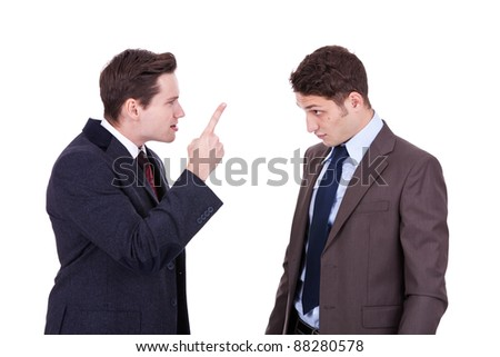 two young businessmen standing, discussing, arguing - isolated on white - stock photo