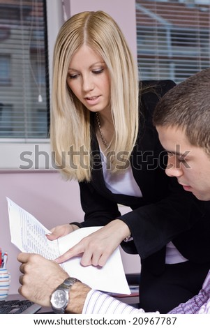 two young businesspeople at the office - stock photo