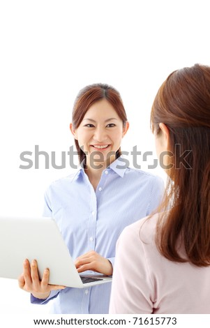 Two young businesswoman with laptop isolated over white - stock photo