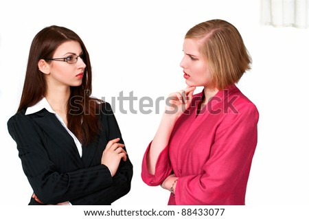 Two young businesswomen in serious conversation