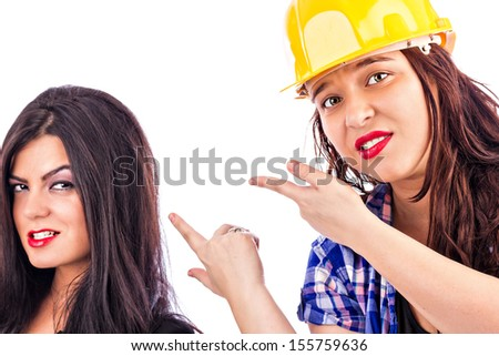 Two young businesswomen working together and competing isolated on white background - stock photo