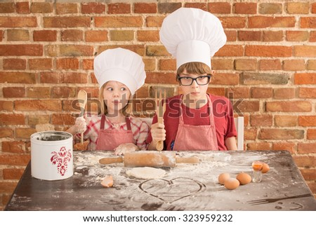 two young chefs, baking a cake  - stock photo