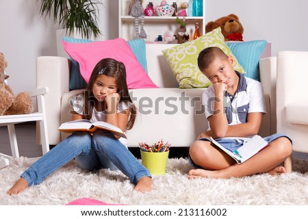 Two young children sick of learning - stock photo