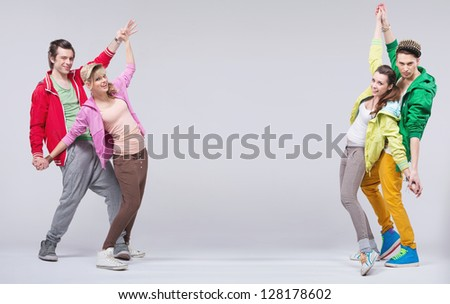 Two young couples dancing - stock photo
