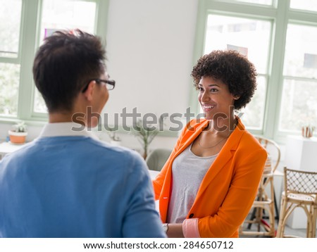 Two young creative entrepreneurs in office - stock photo