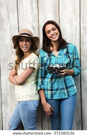 Two young female friends smiling at camera - stock photo