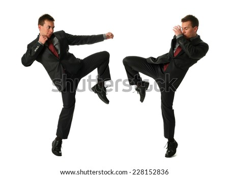 Two young fighting businessmen isolated on white - stock photo