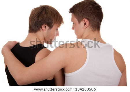Two young gay man hugging each other