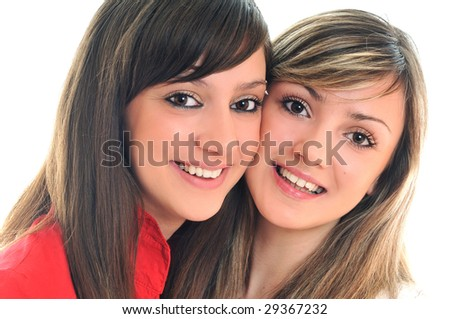 two young girl friend isolated happy on white background