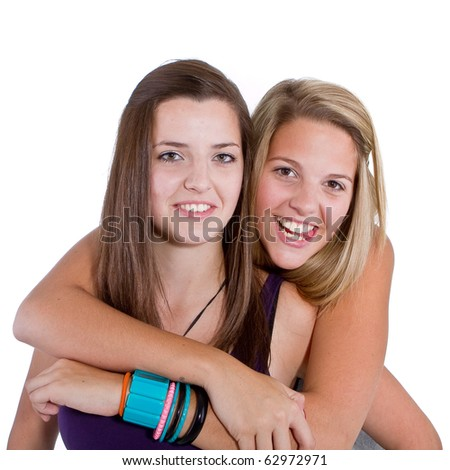 Two young girl friends smiling - isolated over white background. - stock photo