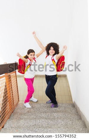 Two young girl - let's go to school. Top view - stock photo