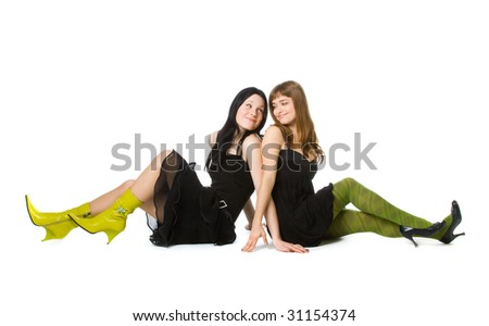 Two young girlfriends. Isolated on white background