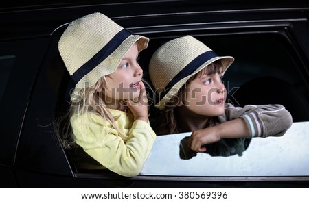 Two young girls are traveling by car - stock photo