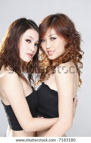 Two young girls close together looking very sensual and sexy