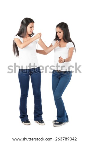 Two young girls dancing isolated - stock photo