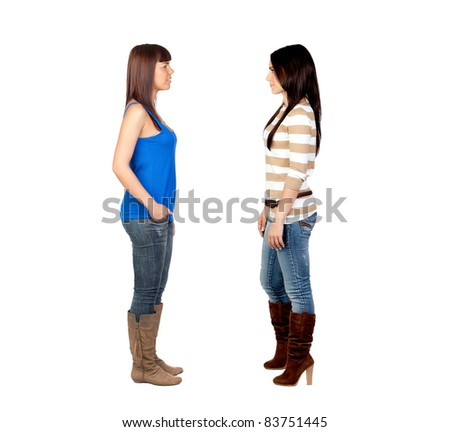 Two young girls face to face on white background - stock photo