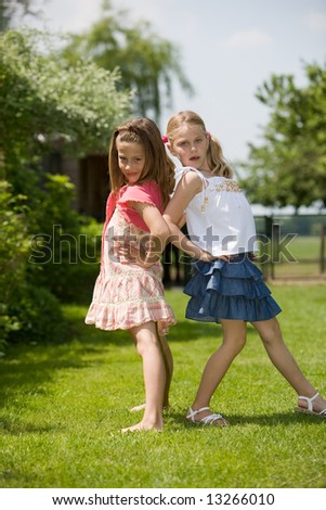 Two young girls having fun posing as real models