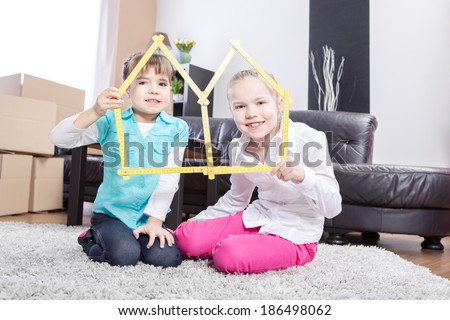 two young girls inside of their new home