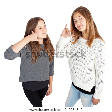 two young girls making a call me gesture - stock photo
