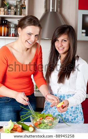 two young girls preparing food  together