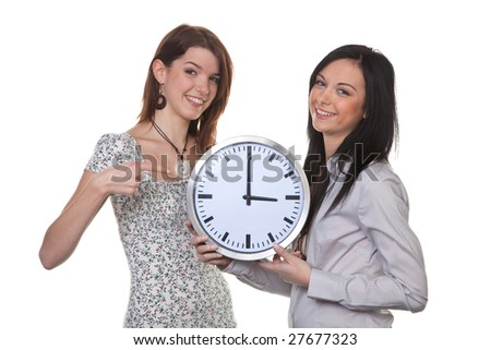 Two young girls show the new time at time changeover