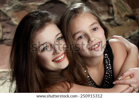 two young girls, sisters. sincere emotions. active. beautiful smile