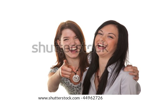 Two young girls to see something very funny and laugh