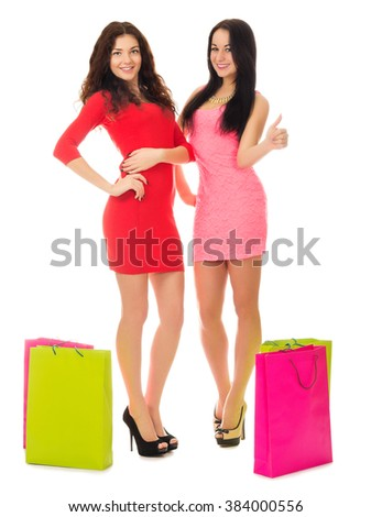 Two young girls with bags isolated - stock photo