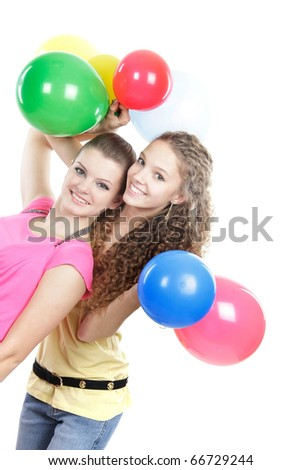 two young girls with balloons over white